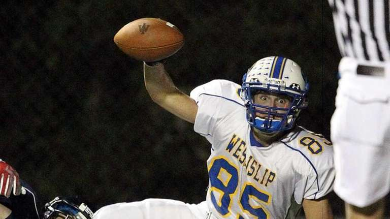 West Islip's player scores on a pass from