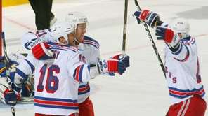 The Rangers' Sean Avery, left, Derek Stepan, center,