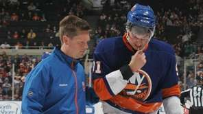 Trainer Garrett Timms walks John Tavares #91 of