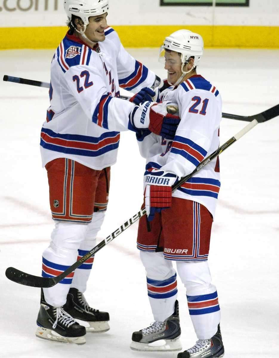 Rangers center Derek Stepan, right, is congratulated by