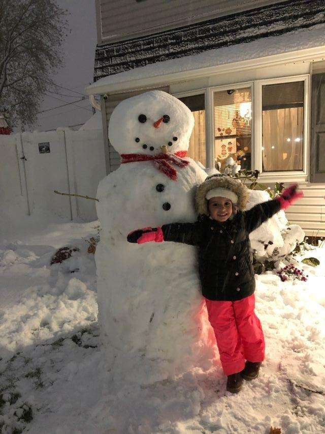 1st snowman of the season with Kylie in