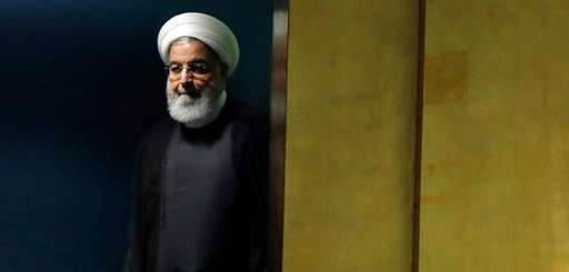 Iran's President Hassan Rouhani arrives to address the