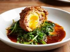 The Scotch egg, soft-boiled and encased in sausage,