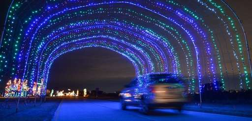 A large, colorful, lighted tunnel at the Holiday