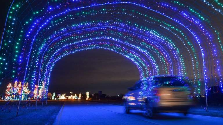 A Large Colorful Lighted Tunnel At The Holiday