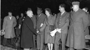 President Harry S. Truman greets members of the