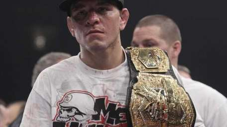 Nick Diaz carries his belt after beating K.J.