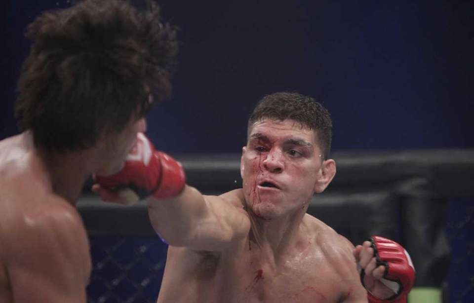 Nick Diaz, right, punches K.J. Noons in the