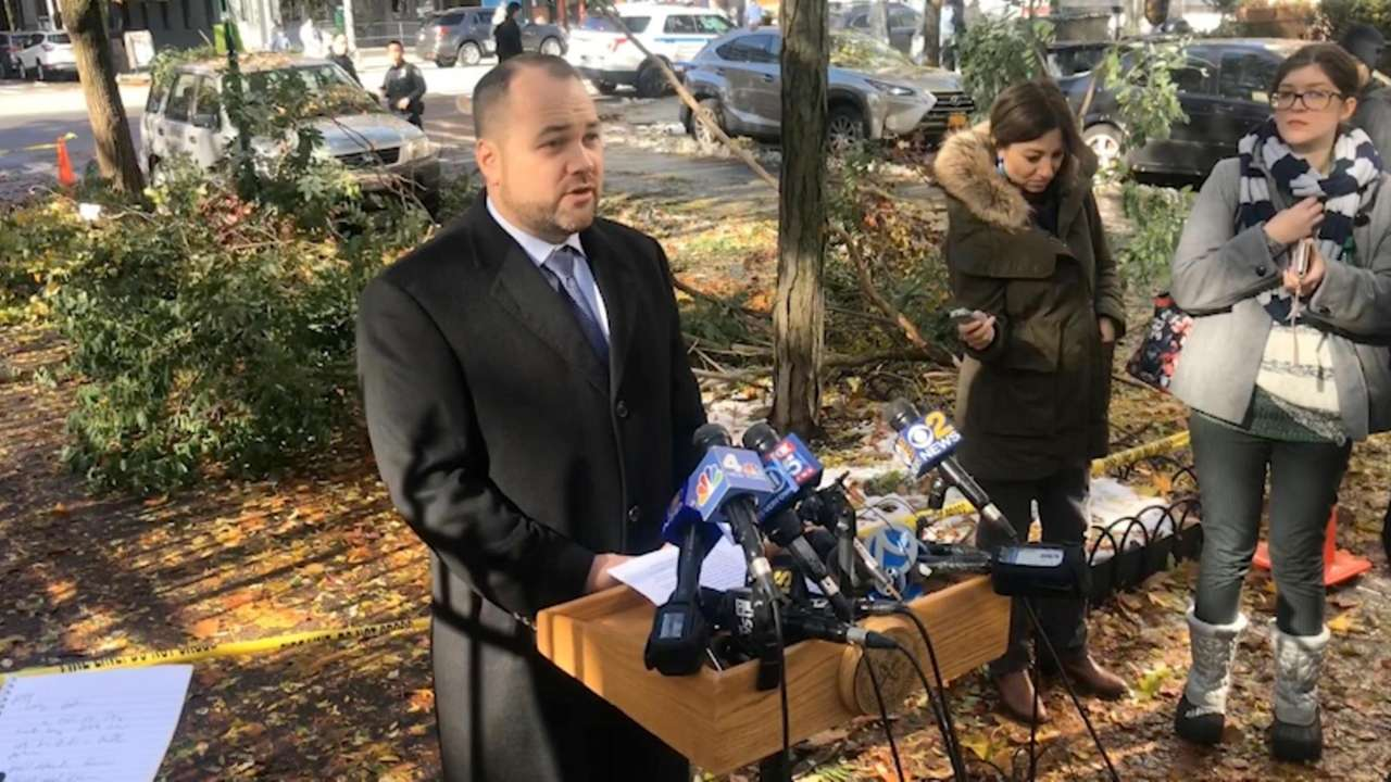 Speaker Corey Johnson (D-Manhattan), standing beside a downed