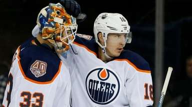 Ryan Strome, right, and Cam Talbot of the