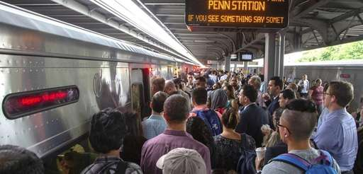 Commuters at Jamaica Station crowd into an LIRR