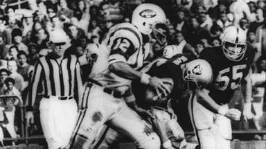 New York Jets' quarterback Joe Namath (12) sweeps