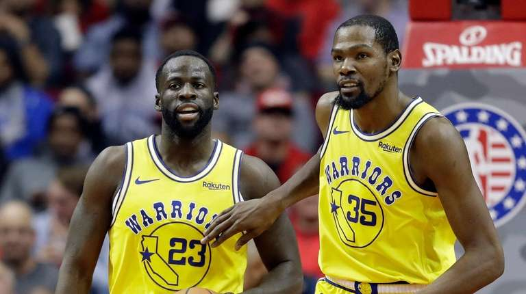 Golden State Warriors' Kevin Durant (35) pats Draymond