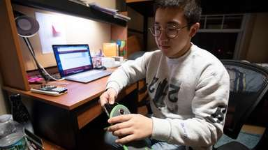 Steve Zhou, 18, a senior at The Stony