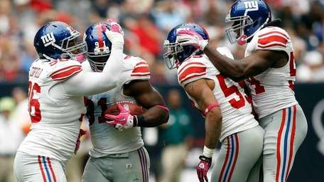: Justin Tuck #91 of the New York