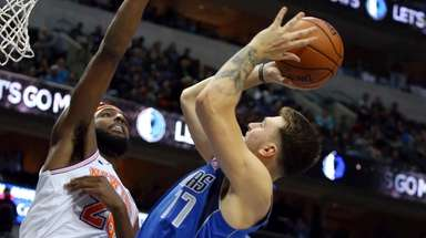 Knicks center Mitchell Robinson, left, shown here defending
