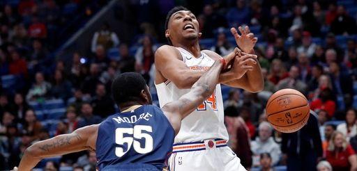 Pelicans guard E'Twaun Moore pokes the ball away