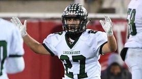LindenhurstÕs Mike Anderson celebrates his touchdown against West