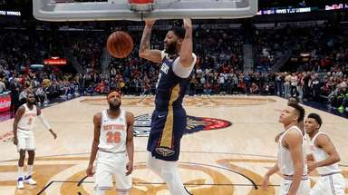 Pelicans forward Anthony Davis dunks for two of