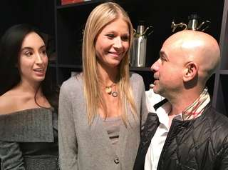 Gwyneth Paltrow, center, chats with guests Gina Frocarro