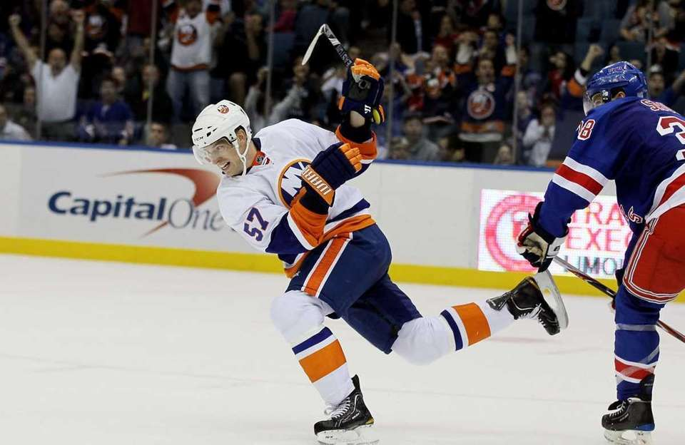 The Islanders' Blake Comeau celebrates after scoring the