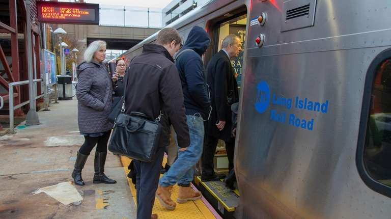 Commuters at the Mineola LIRR station on Tuesday.