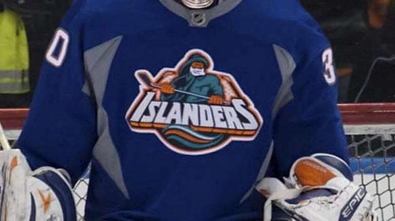 Former New York Islanders goalie Chad Johnson wears