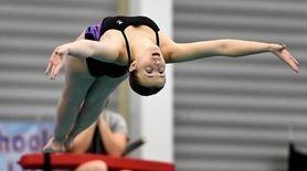 Sayville-Bayport-Blue Point's Megan Romano executes a dive during