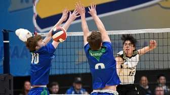Sachem North's A.J. Fitzgerald (19) spikes the ball