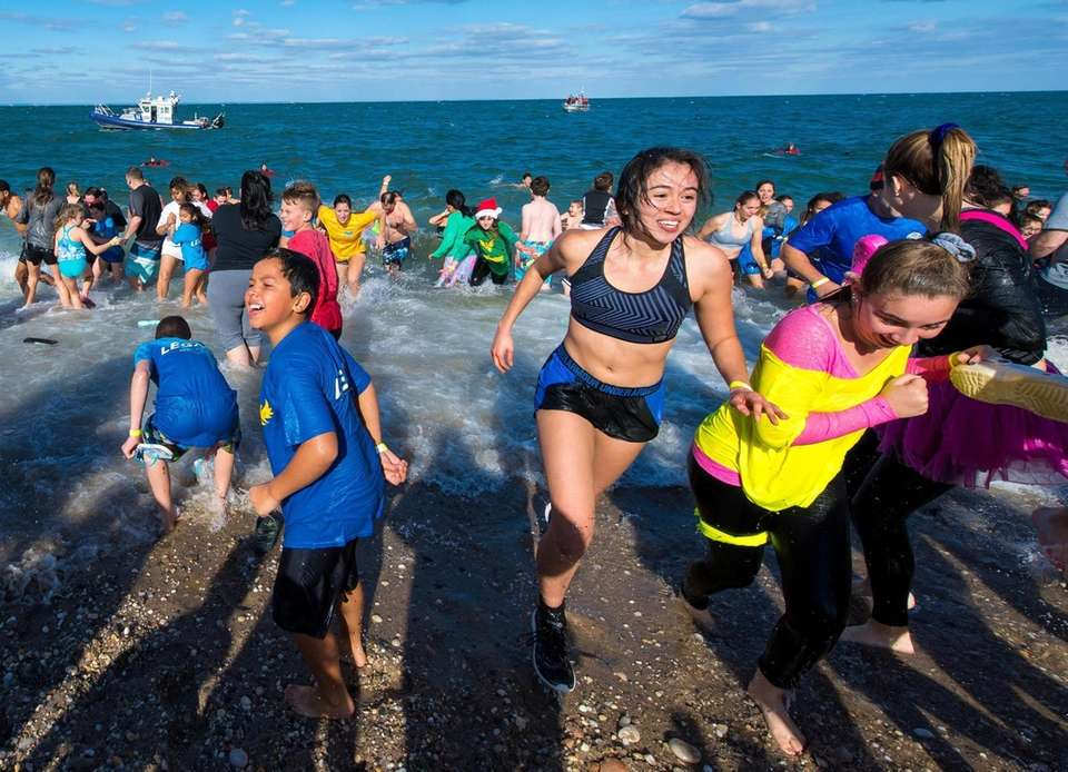 Swimmers take a plunge into the chilly waters