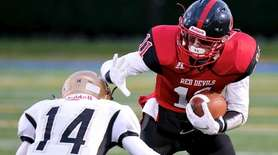 Plainedge WR Joe Yarusso tries to avoid the