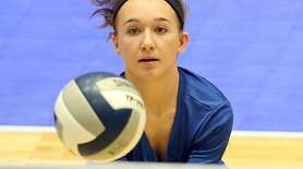 Mattituck's Emily McKillop goes for the dig during