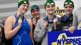 Ward Melville swimmers celebrate their finish in the
