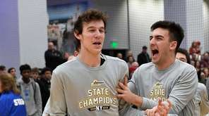 Bellmore JFK's Tyler Anderson ,left, reacts after being