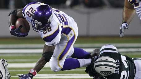 Minnesota Vikings' Adrian Peterson is tackled by New