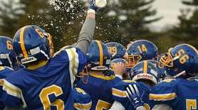 Kellenberg teammates celebrate after their 41-6 wn over