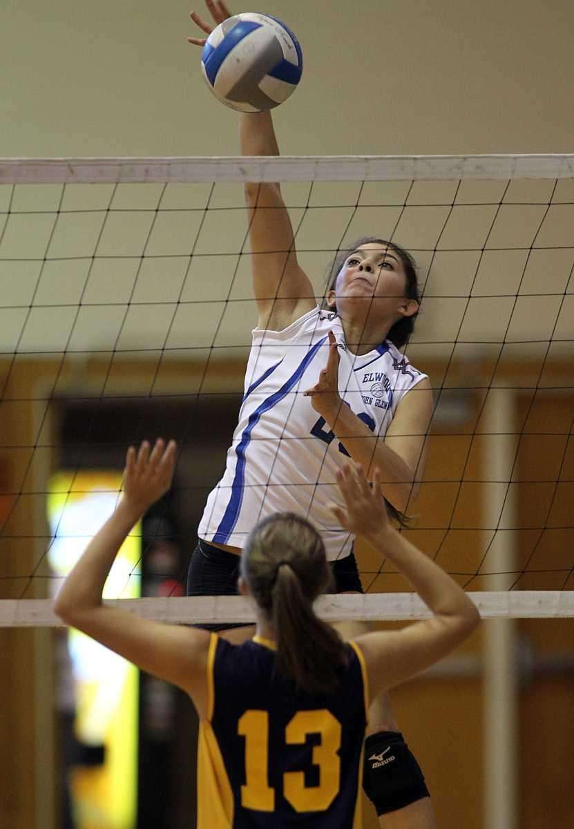 EASGlenn's Karen Canales (28) with the spike over