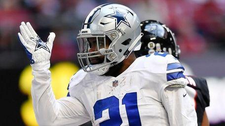 Cowboys running back Ezekiel Elliott signals a first