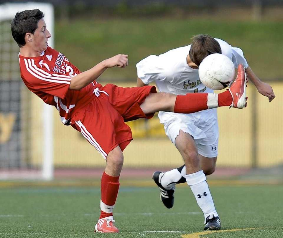 St. Anthony's Brendan Hayes (right) heads the ball