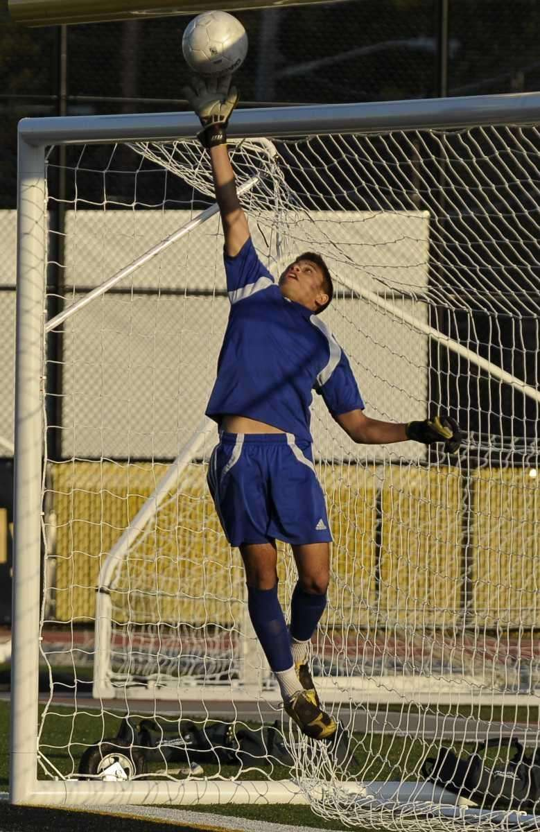 St. Anthony's Stephan Singson saves a shot on