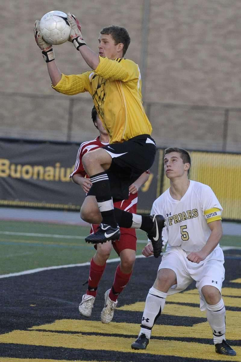 St. Anthony's Anthony Lopatowski leaps for a save