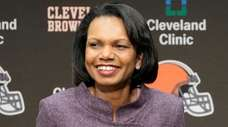 Former Secretary of State Condoleezza Rice talks with