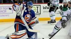 Islanders goalie Thomas Greiss makes the save on