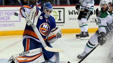 Islanders goalie Thomas Greiss makes the save on