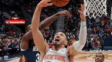 Knicks center Enes Kanter battles under the basket