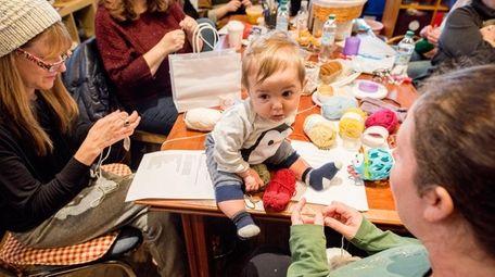 Isaac Kantor, 4 months, accompanies his mother, Kim,