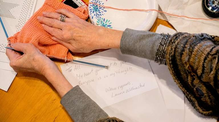 Diane Greenlick of Manhasset knits during a community
