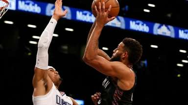 The Nets' Allen Crabbe goes to the hoop