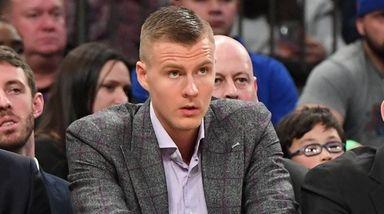 New York Knicks forward Kristaps Porzingis, center, looks