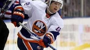 The Islanders' Josh Bailey shoots the puck in